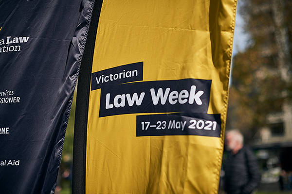 Yellow flag with text: Victorian Law Week 17-23 May 2021